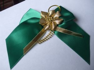 Green Ribbon Bow with Gold Flower Centre
